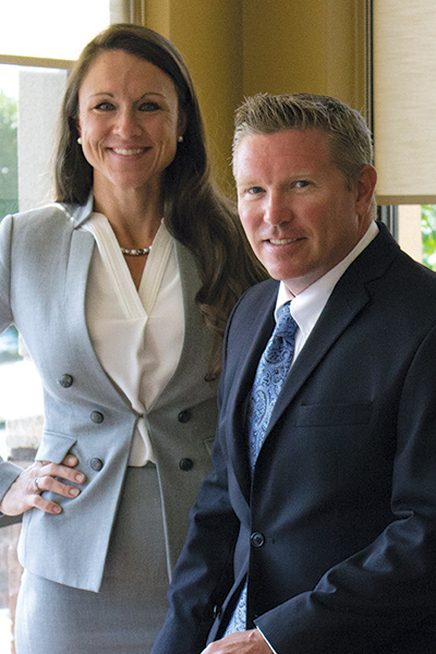 Photo of Melissa Page Boeshans and Jason Groth of The Servion Group