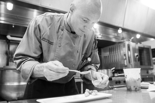 Chef Hakan Lundberg of The Minneapolis Club in the kitchen