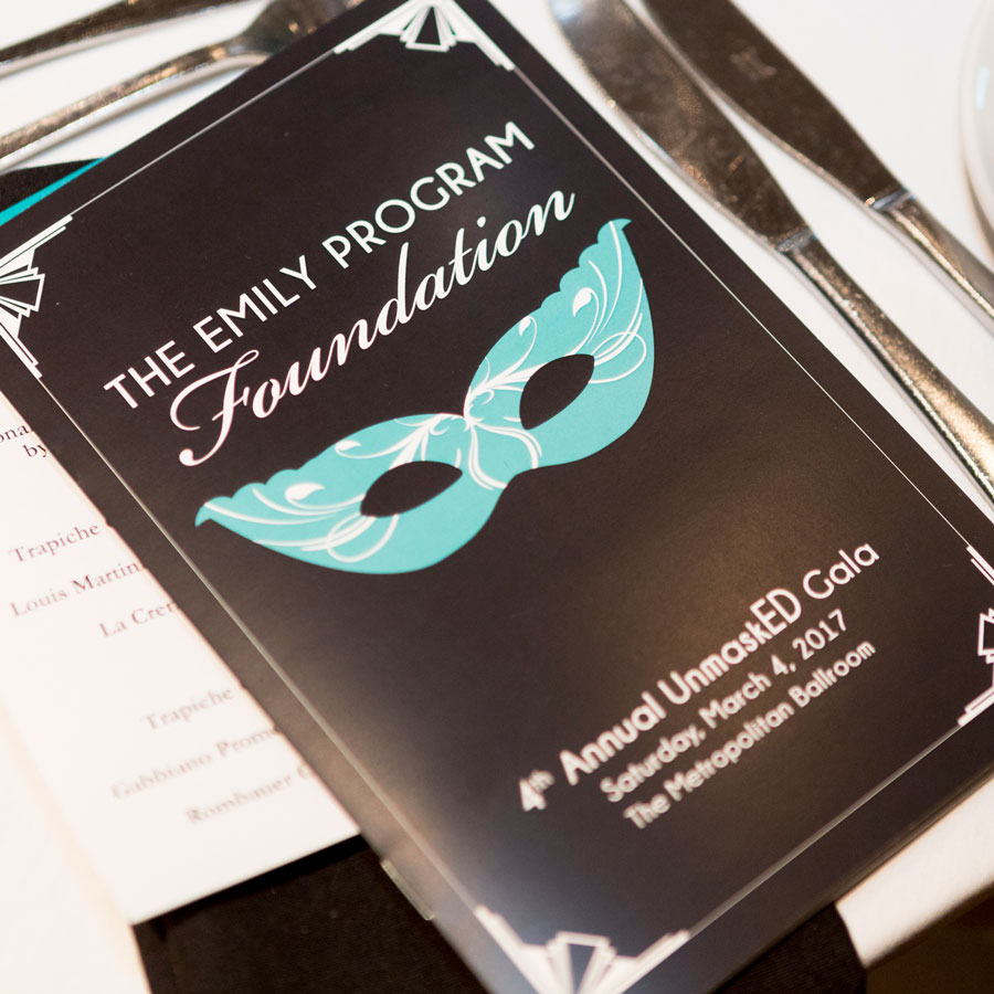 A brochure for the Emily Program's UnmaskED Gala.