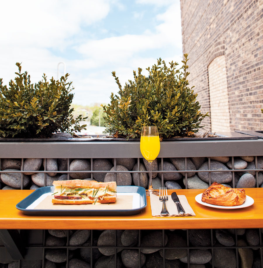 A sandwich and cocktail on a table on the patio at Bachelor Farmer Cafe in Minneapolis' North Loop neighborhood.