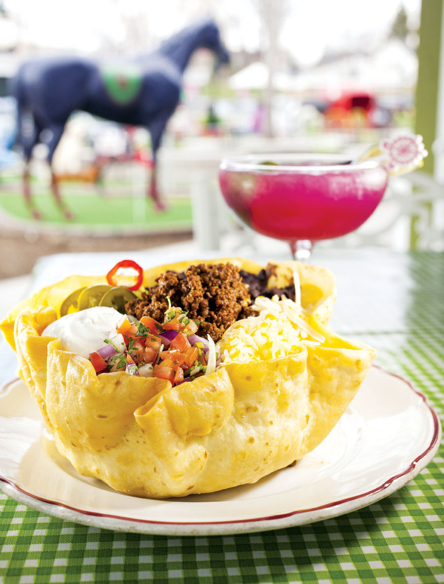 A taco bowl and fruity cocktail at Betty Danger's Country Club in Northeast Minneapolis.