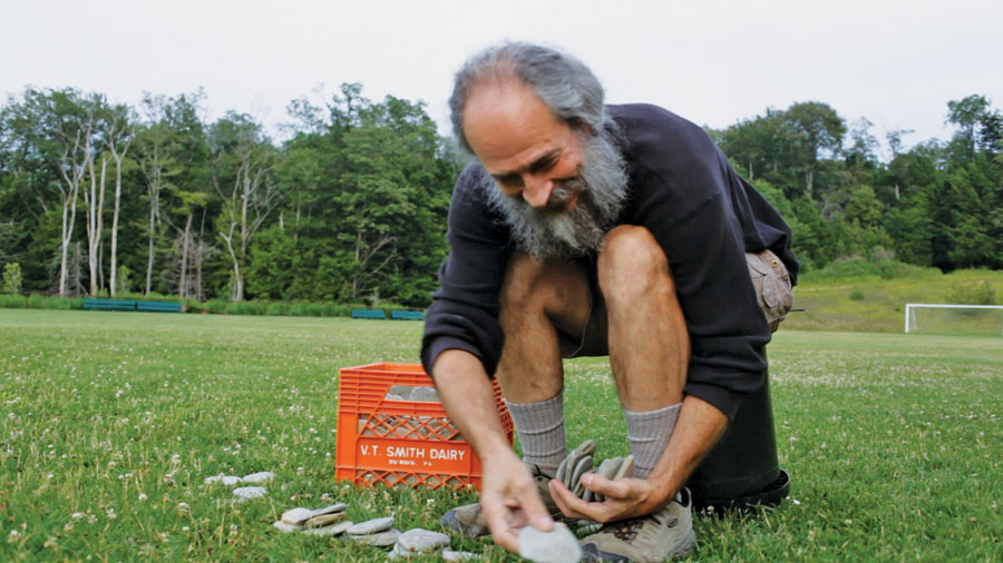"Kurt ""Mountain Man"" Steiner sorting his skipping stones."