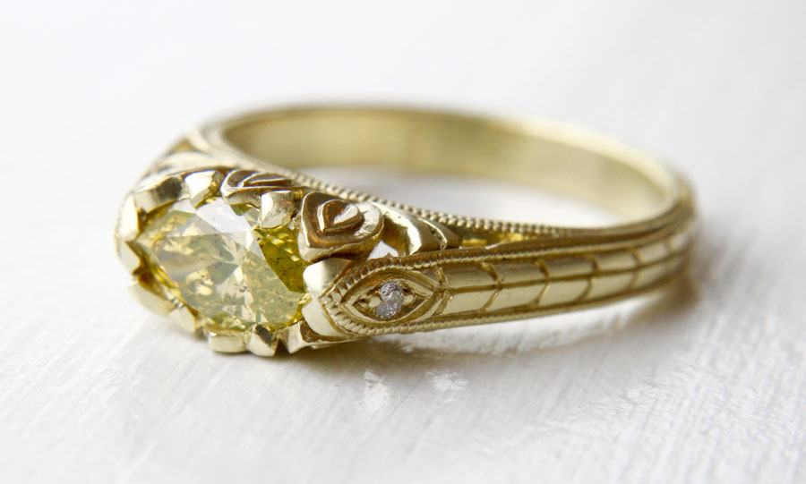Natural yellow green .48 carat diamond in hand carved 14K green gold setting by Kelsey Lee-Karol, $7,000.