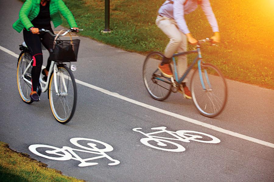 Two cyclists on a bike path.