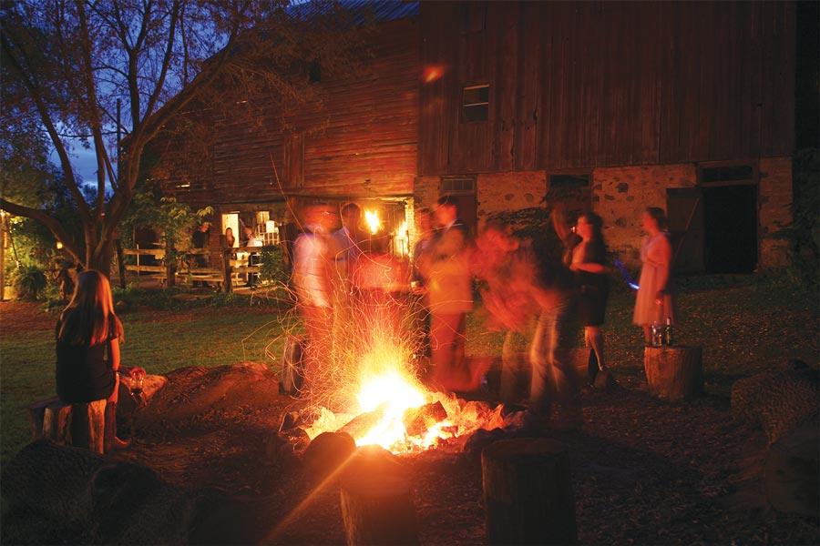 People gathered around a bonfire at night.