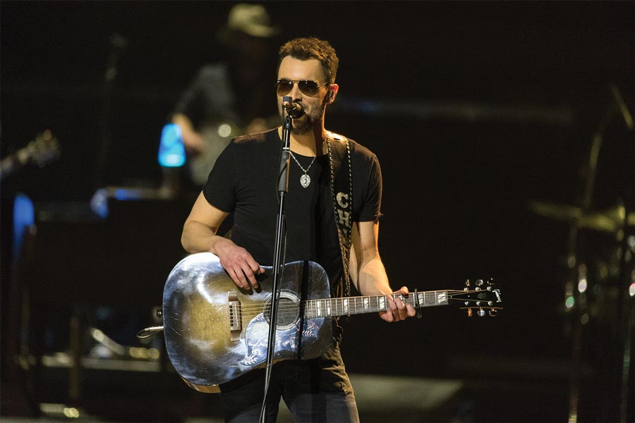 Eric Church playing guitar.