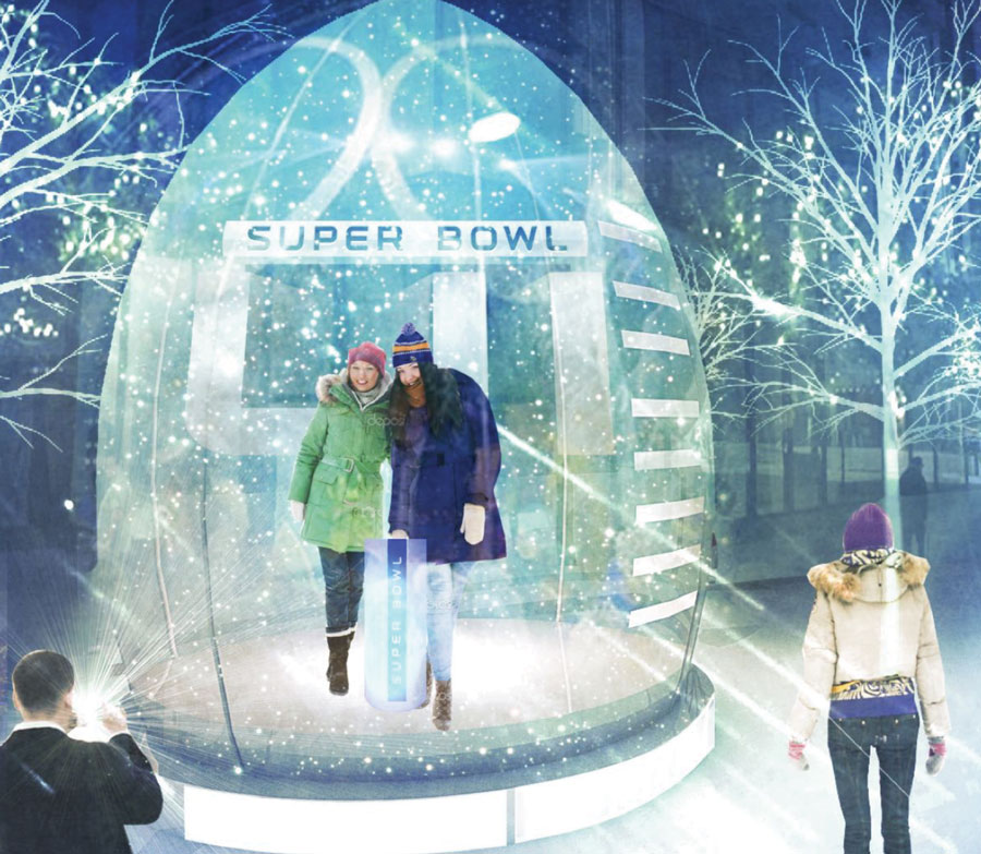 Two people posing for a picture inside a snow globe at Super Bowl Live.