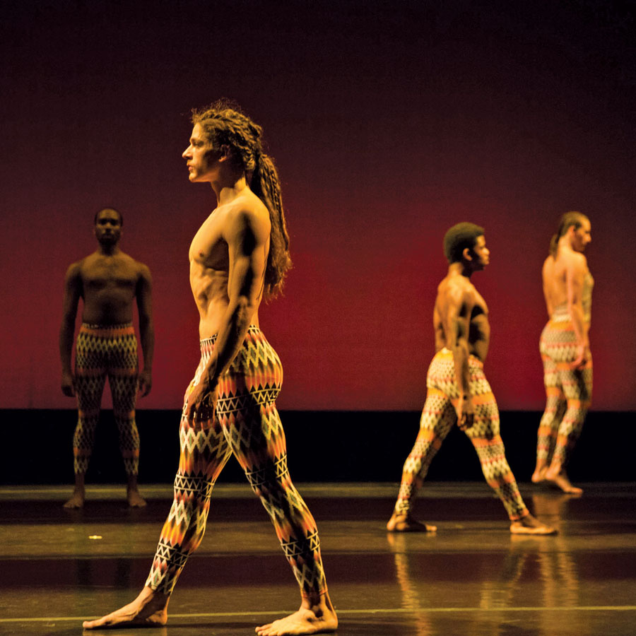 Shirtless dancers performing in Contempo Physical Dance's production of Vulcao.