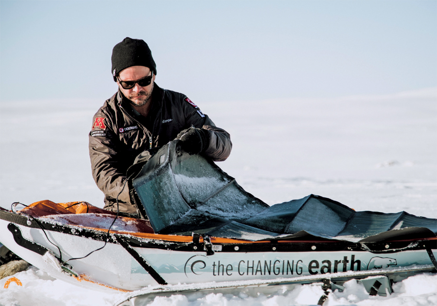 Aaron Doering attaching a solar panel to his pulk during his Changing Earth expedition in the highlands of Iceland in March 2017. The solar panel charges a portable battery tucked inside the pulk as Doering skis 8-10 hours between camps.