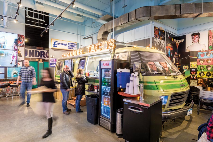 People dining at a Food Truck Hall.