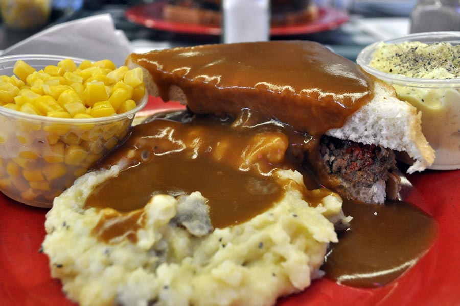 A roast beef sandwich, corn and mashed potatoes with gravy from Wally's Roast Beef in Bloomington, Minnesota.