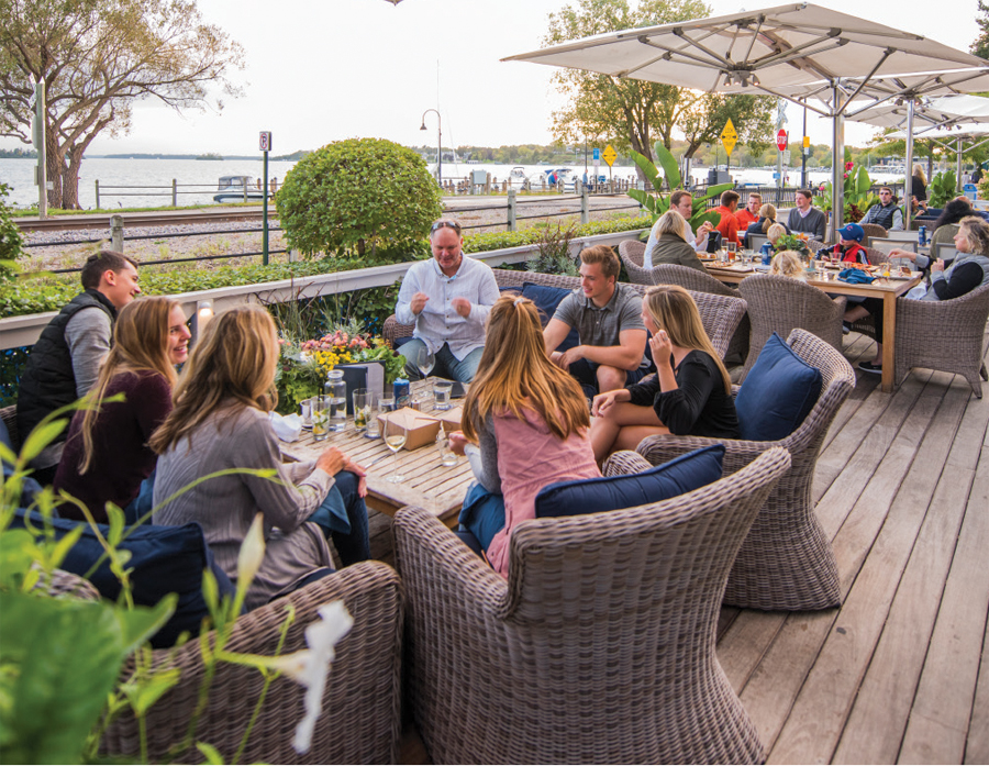 People dining on the patio at CoV Wayzata.