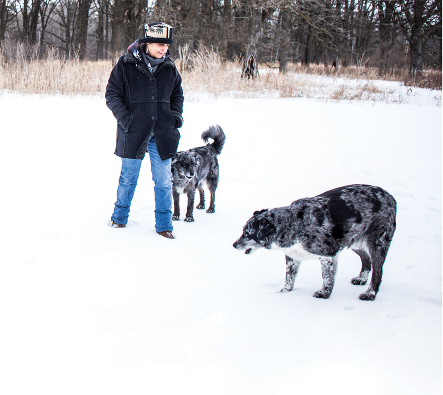 Winona LaDuke playing with her dogs.