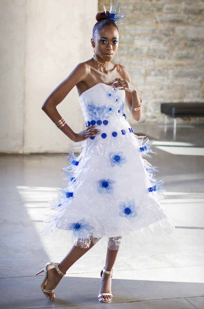 A girl modeling a white and blue dress for Fashion Week MN.