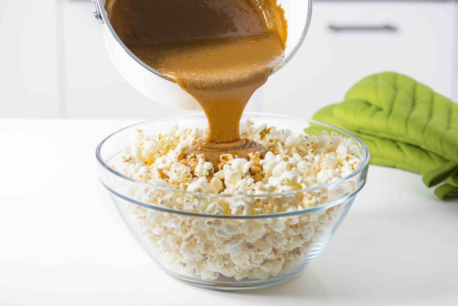 While it may sound intimidating, just pour the caramel into the popcorn bowl and start mixing it up. It will all distribute evenly, we promise! Photo courtesy of the Popcorn Board.