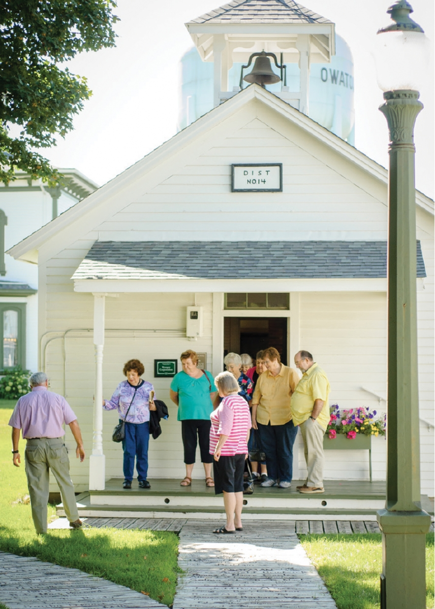 People outside of a building at the Village of Yesteryear in Owatonna, MN.