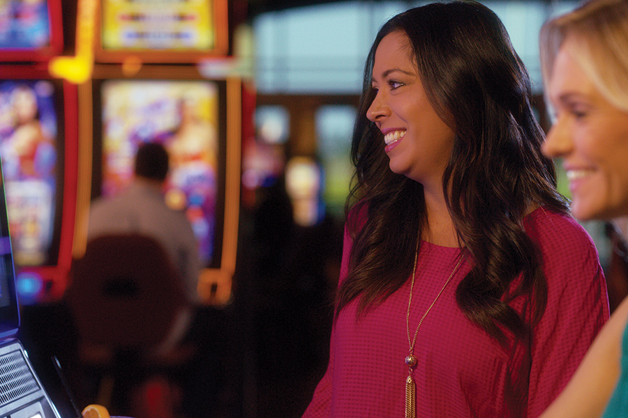 Two girls playing the slot machines at Prairie's Edge casino in Granite Falls, Minnesota.