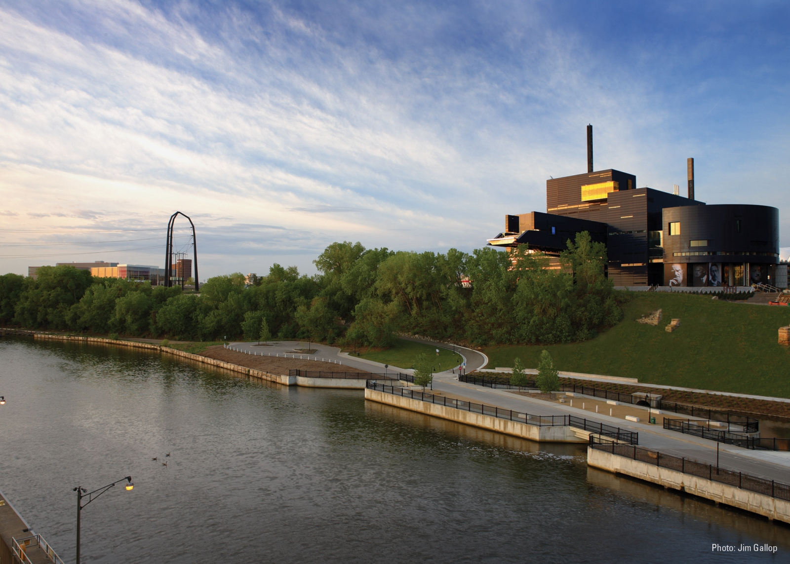 By Gallop Studios, courtesy Guthrie Theater. The Guthrie Theater on the Mississippi Riverbank at sunset.