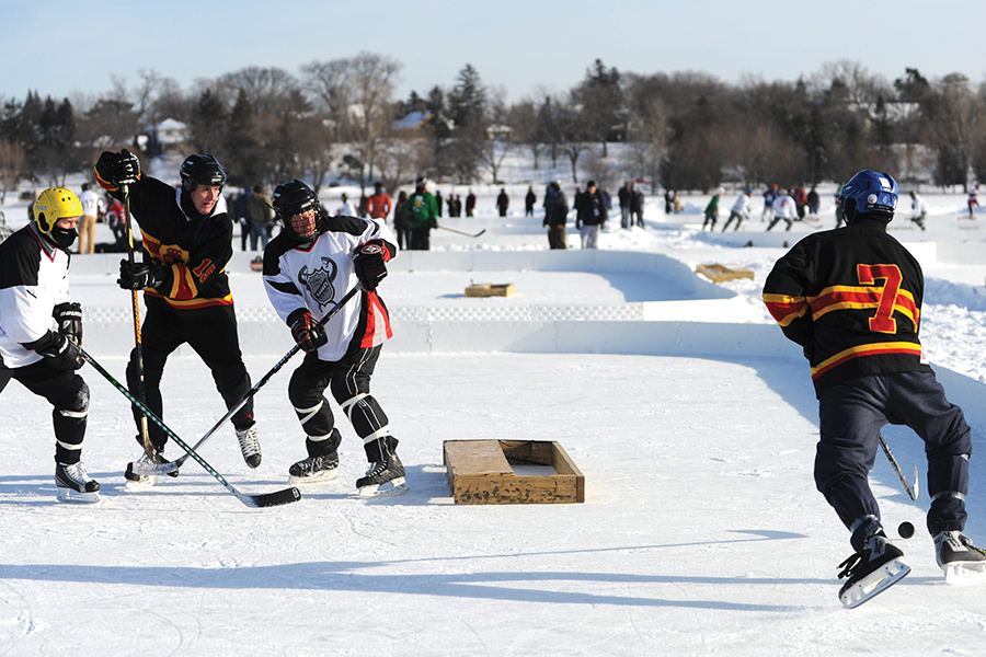People playing hockey at U.S. Pond Hockey Championships during The Great Northern.