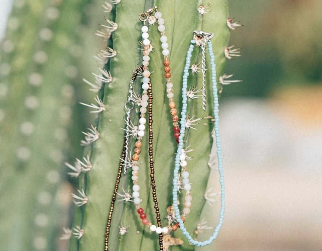Chokers from Hanmade Co., featuring bronze beads, natural stone, and turquoise. Photo by Austin Hilgenberg.