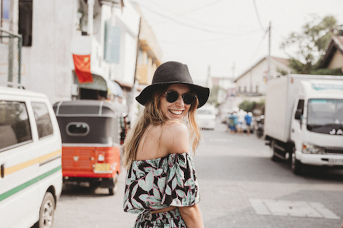 Fashionable woman smiling.