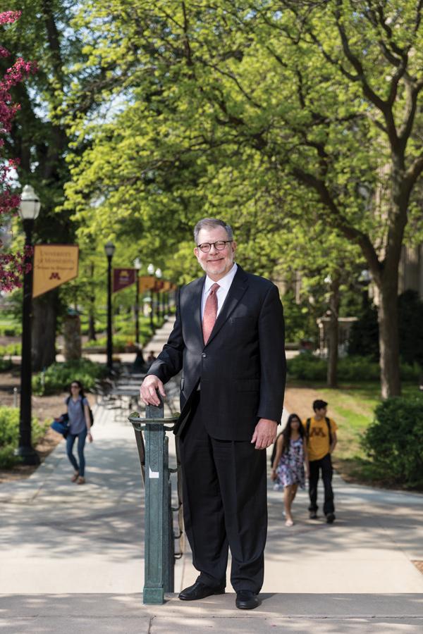 A portrait of University of Minnesota President Eric Kaler standing outside on some steps.