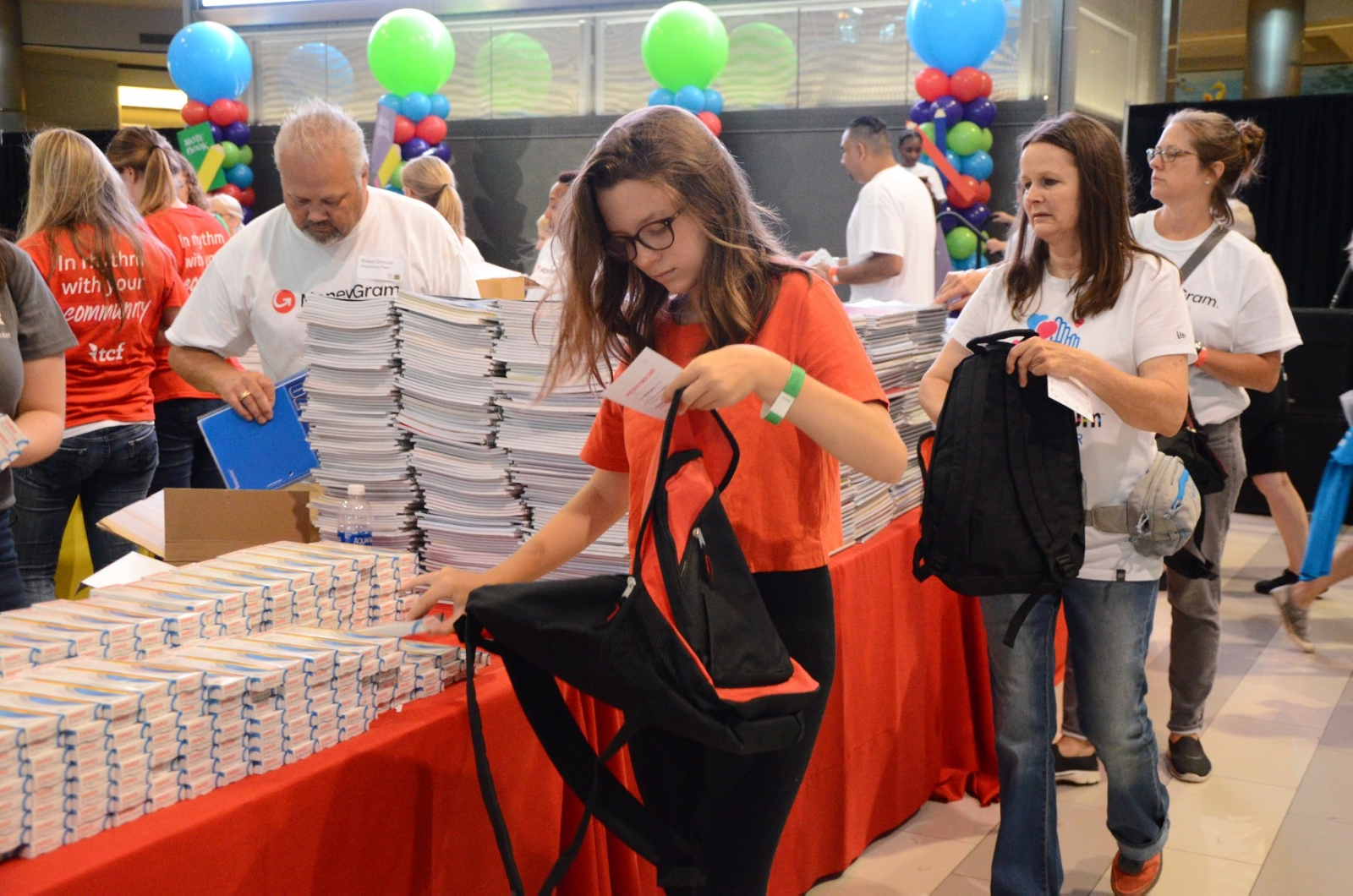 Adults and youth go through the lines to help pack the backpacks. Photos courtesy Mike Madison and Renee Maiz.