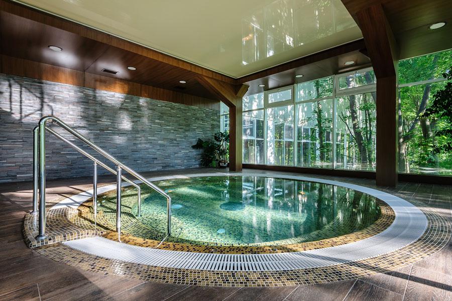 A large hot tub inside a spa.