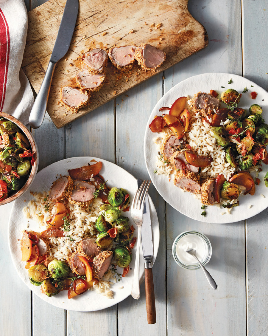 A table laid with the pork tenderloin with sautéed apples from Siri Daly's Siriously Delicious.