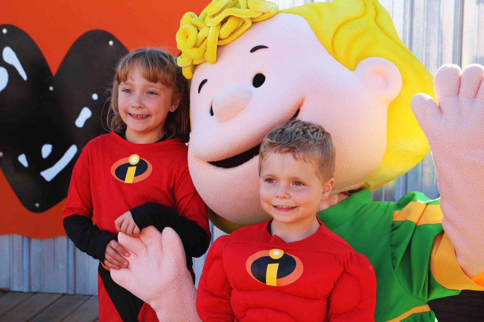 Two kids in their Halloween costumes taking a picture with a Peanuts mascot. Courtesy Valleyfair.