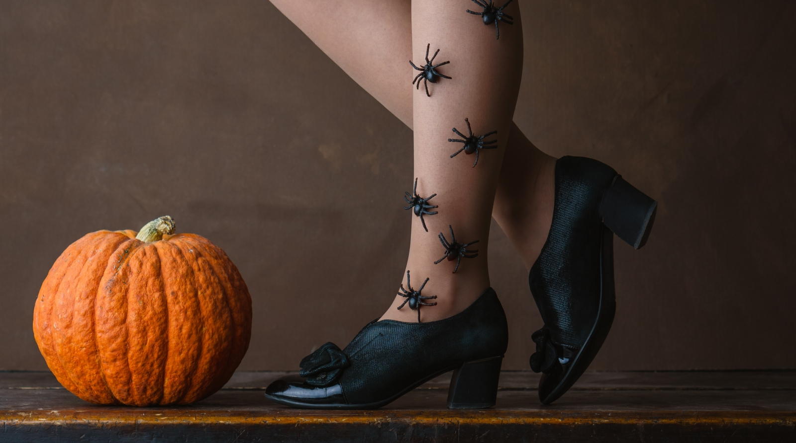 Vintage shoes, a pumpkin, and spiders make this vintage Halloween photo. Courtesy LMproduction/Fotolia.