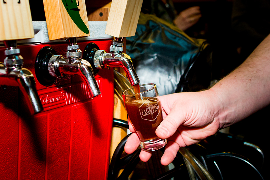 Pouring a beer from a cooler-turned-tap at Grand Brewfest