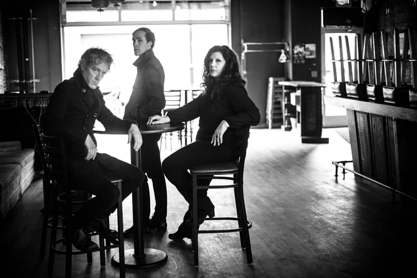 A black and white portrait of the band Low.