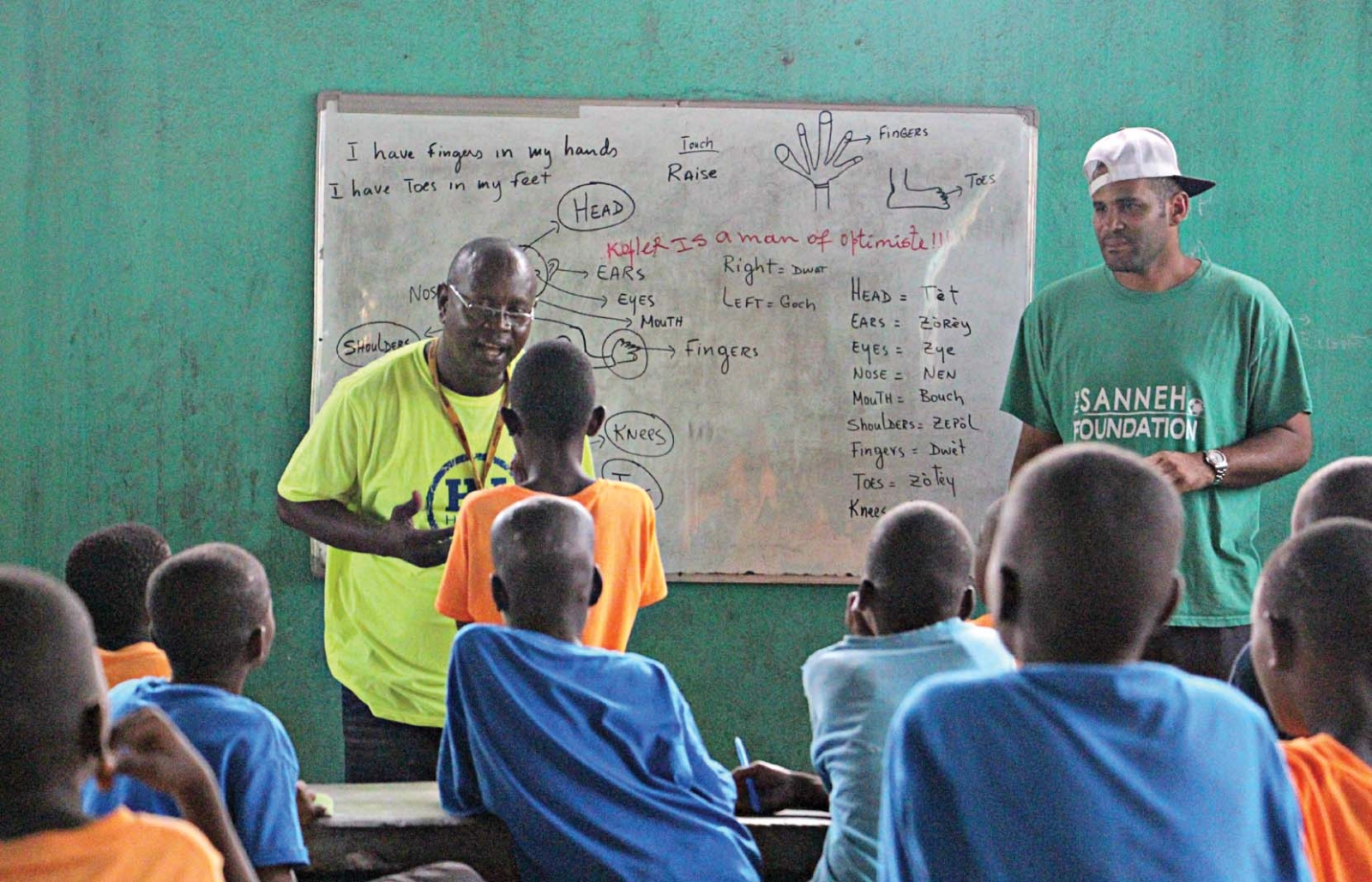 Sanneh's Haitian Initiative in Port-au-Prince, Haiti, rewards passing grades and school attendance with soccer training and hot meals.