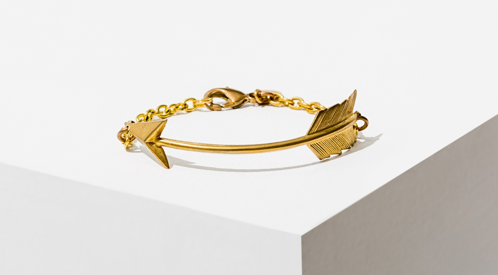 A brass-plated arrow hammered into a cuff by Larissa Loden.