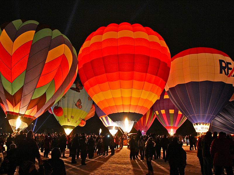 Hot air balloons at night in Hudson, Wisconsin