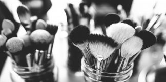 Makeup brushes in mason jars in black and white filter