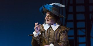 Cyrano de Bergerac Guthrie 3-19 1028 Cyrano de Bergerac , by Edmond Rostand, directed by Joseph Haj Guthrie Theater 3/15/19 Lighting Design: Rui Rita Scenic Design: McKay Coble Costume Design: Jan Chambers Photograph © T Charles Erickson tcepix@comcast.net http://tcharleserickson.photoshelter.com/