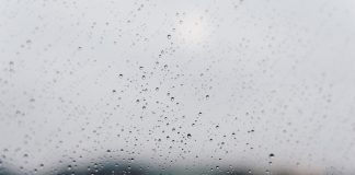 Photo of close up of raindrops on window