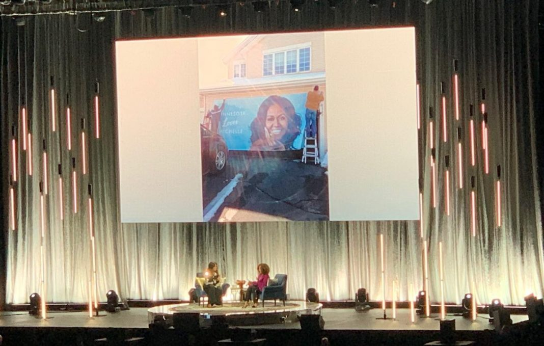 Brundidge managed to get a shot of her poster featured during Michelle Obama's talk with Michele Norris