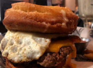Copper Cow Donut Burger with bacon, cheddar, fried egg, maply syrup aioli ($14)