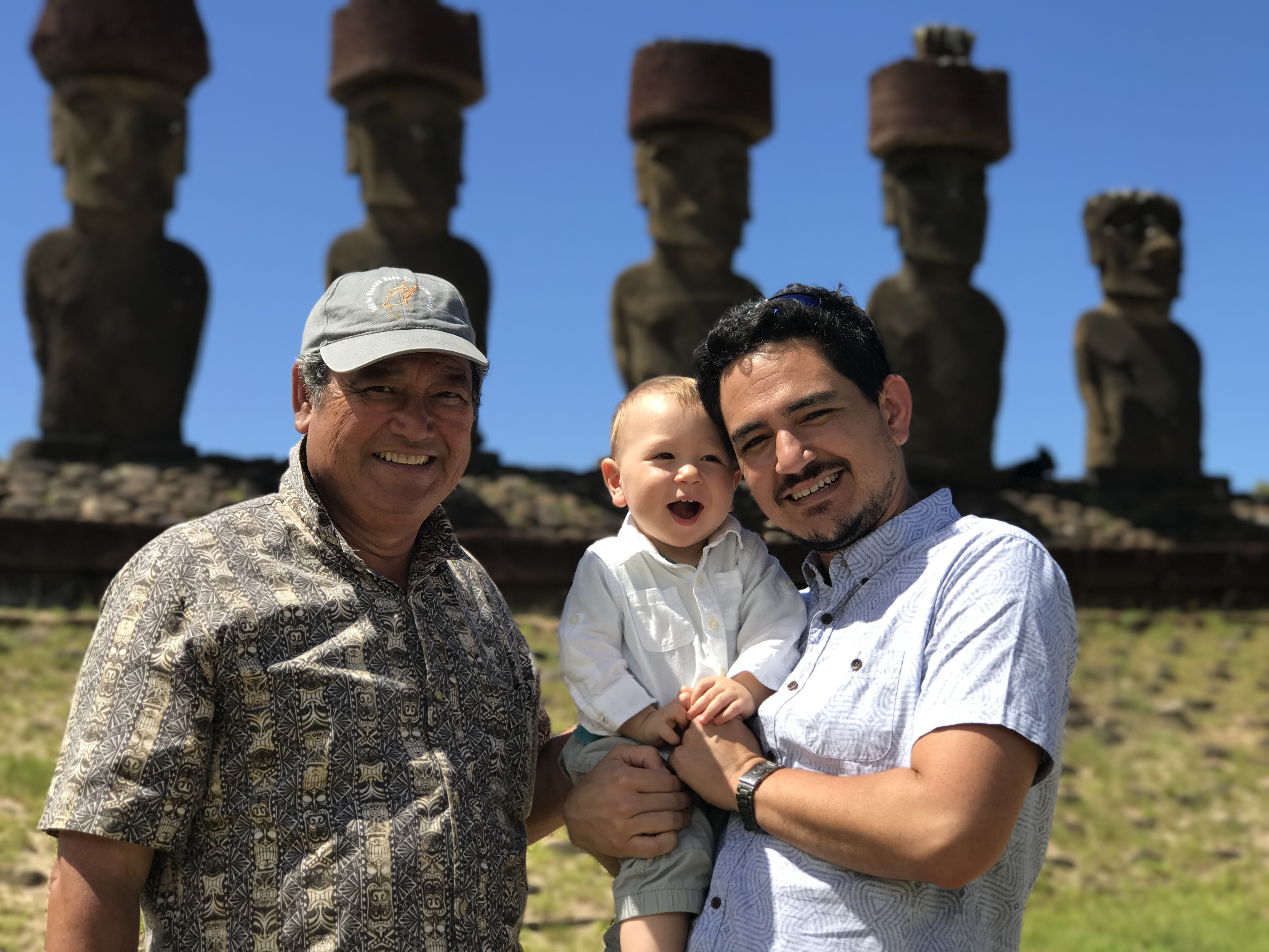 Sergio Mata'u Rapu stands with his father and his son in front of the Easter Island statues.