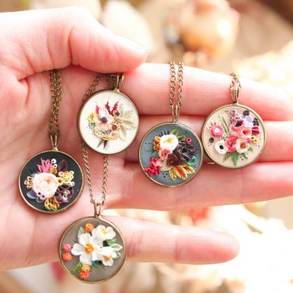 Five beautiful spring flower necklace pendants created by Earth Clay Co.