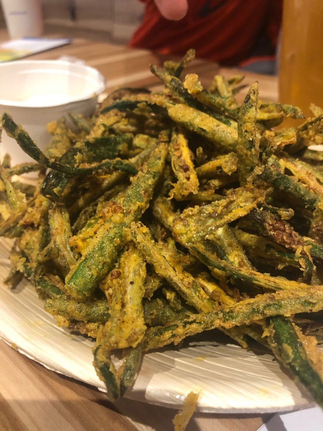 Cayenne-Dusted Crispy Okra Fries ($8) with black salt