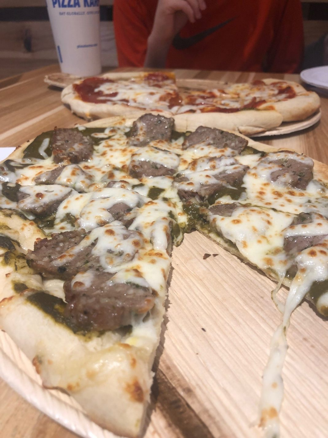 Lamb meatball pizza with mustard-spinach sauce on garlic-cilantro naan