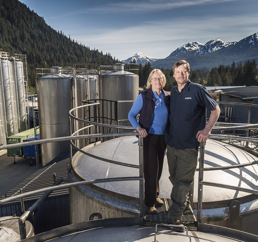 Founders of brewery in front of mountains