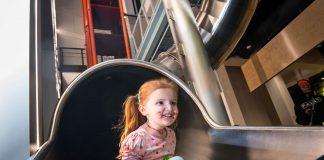 Photo of child on slide