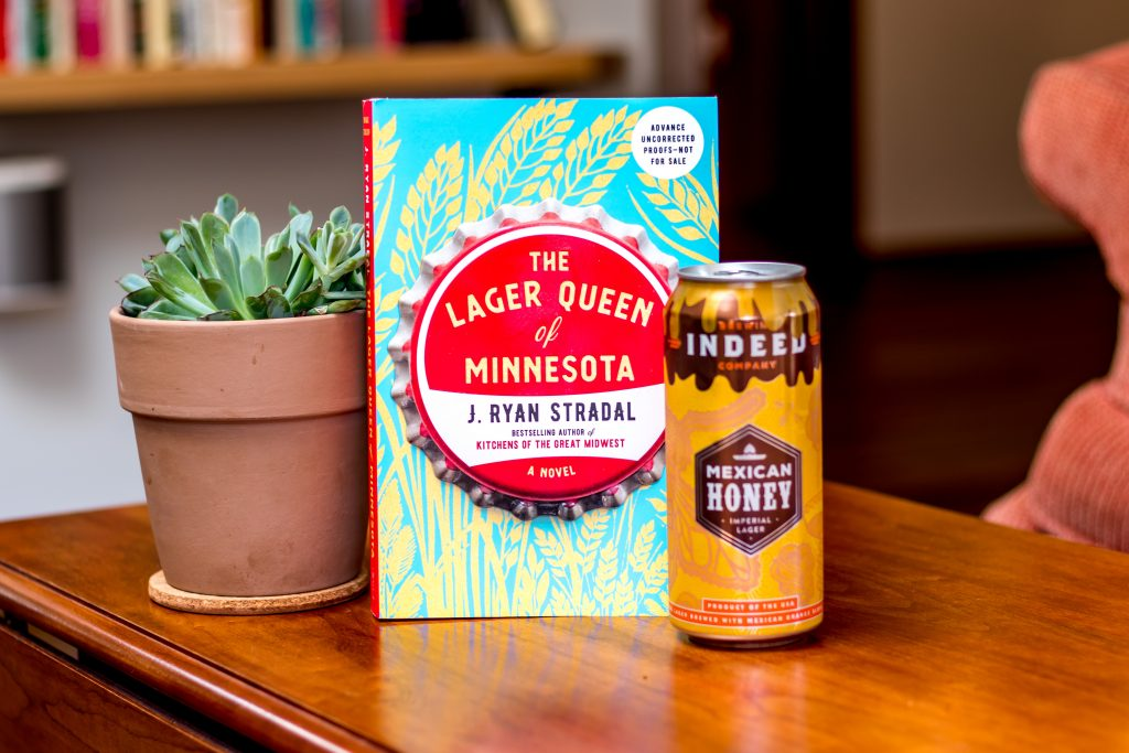 Image of succulent plant, The Lager Queen of Minnesota book, and Mexican Honey Imperial Lager From Indeed Brewing Company