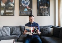 Jason Matheson catching up on a few of his favorite subjects at his North Loop condo