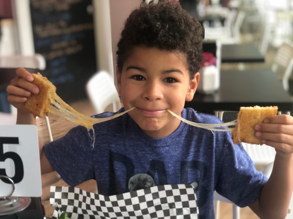 Child eating grilled cheese